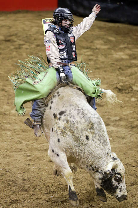 Chandler Bownds, from Lubbock, TX, competes in the bull riding event during the second night of the two-night rodeo competition semifinals of the San Antonio Stock Show and Rodeo at the AT&T Center on Friday, Feb. 27, 2015.  Bownds scored a 88 on his ride.  MARVIN PFEIFFER/ mpfeiffer@express-news.net Photo: Marvin Pfeiffer, Staff / San Antonio Express-News / Express-News 2015