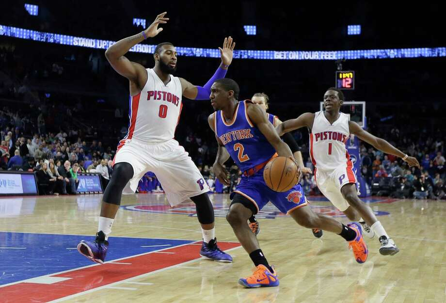 New York Knicks guard Langston Galloway (2) drives on Detroit Pistons center Andre Drummond (0) during the first half of an NBA basketball game, Friday, Feb. 27, 2015 in Auburn Hills, Mich. (AP Photo/Carlos Osorio) ORG XMIT: MICO101 Photo: Carlos Osorio / AP