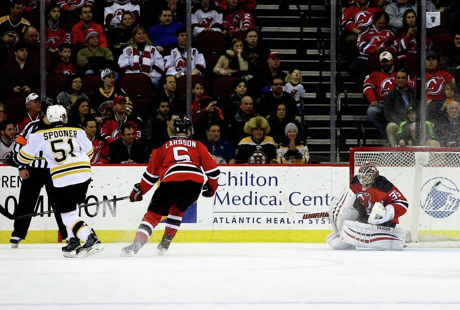 NEWARK, NJ - FEBRUARY 27:  Cory Schneider #35 of the New Jersey Devils gives up the winning goal scored in overtime by Ryan Spooner #51 of the Boston Bruins during their game at the Prudential Center on February 27, 2015 in Newark, New Jersey.  (Photo by Al Bello/Getty Images) ORG XMIT: 507050299 Photo: Al Bello / 2015 Getty Images