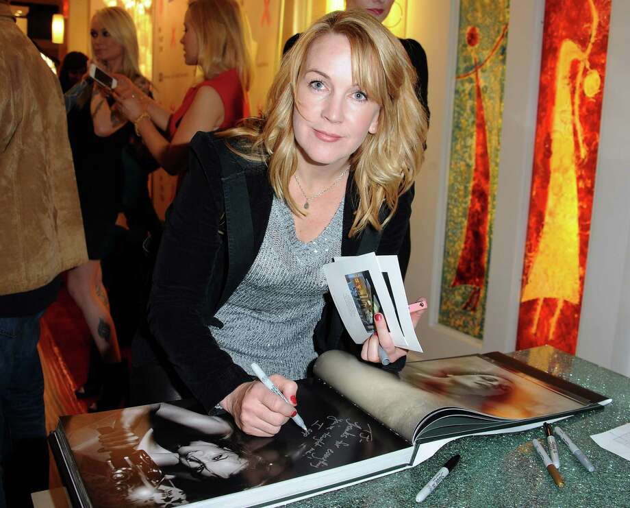 And here's Renee O'Connor, 44, at a book party and benefit on Dec. 12, 2013 in Los Angeles. Photo: Albert L. Ortega, Getty Images / 2013 Albert L. Ortega