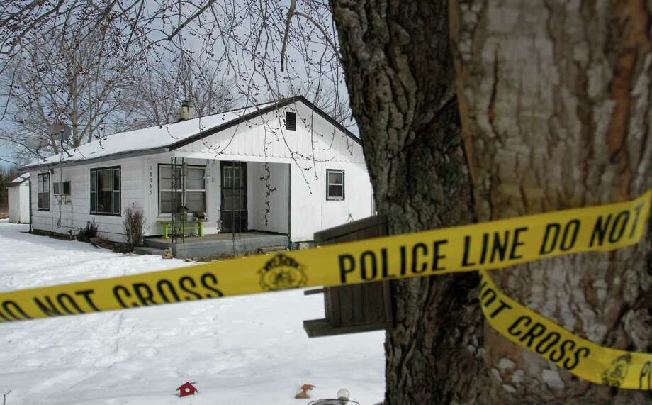 Police tape surrounds one of the five crime scenes near rural Tyrone, Mo., on Friday morning. Photo: Nathan Papes /Associated Press / The Springfield News-Leader