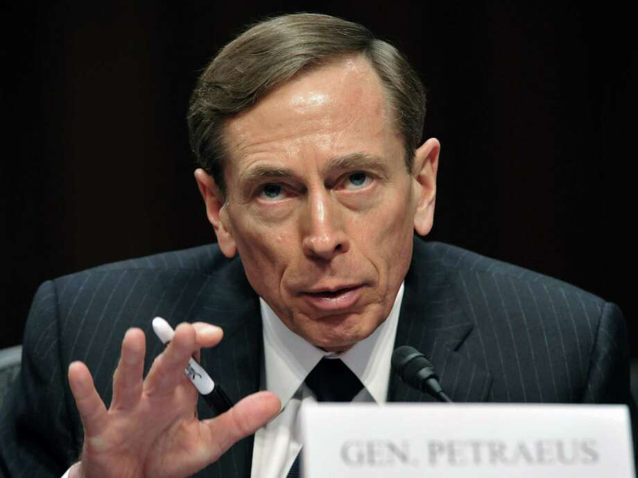 """(FILES) This January 31, 2012 file photo shows then CIA Director David Petraeus testifying before the US Senate Intelligence Committee hearing on """"World Wide Threats"""" on Capitol Hill in Washington, DC.   Two prominent US lawmakers, Sen Diane Feinstein, D-CA, and Sen. John McCain, R-AZ, came to the defense January 11, 2015 of Petraeus, the retired general and former CIA chief under an FBI investigation for allegedly leaking classified information to his former mistress.  AFP PHOTO / KAREN BLEIER / FILESKAREN BLEIER/AFP/Getty Images Photo: KAREN BLEIER, Staff / AFP / Getty Images / AFP ImageForum"""