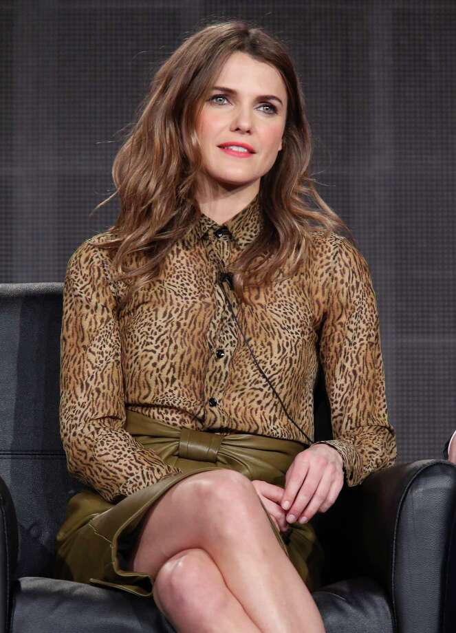 "Keri Russell, 38, speaks onstage during a panel discussion of her series ""The Americans"" on Jan. 18, 2015 in Pasadena, Calif. But where are the curls? Photo: Frederick M. Brown, Getty Images / 2015 Getty Images"