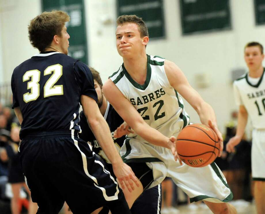 Schalmont's Nick Bird, right, drives to the hoop as Cohoes' Thilo Bell defends during their Class B boys basketball game on Friday, Feb. 27, 2015, at Shenendehowa High in Clifton Park, N.Y. (Cindy Schultz / Times Union) Photo: Cindy Schultz / 00030778A