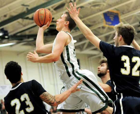 Schalmont's Nick Bird, center, goes to the hoop as Cohoes' Shelton Alston, left, and Thilo Bell defend during their Class B boys basketball game on Friday, Feb. 27, 2015, at Shenendehowa High in Clifton Park, N.Y. (Cindy Schultz / Times Union) Photo: Cindy Schultz / 00030778A