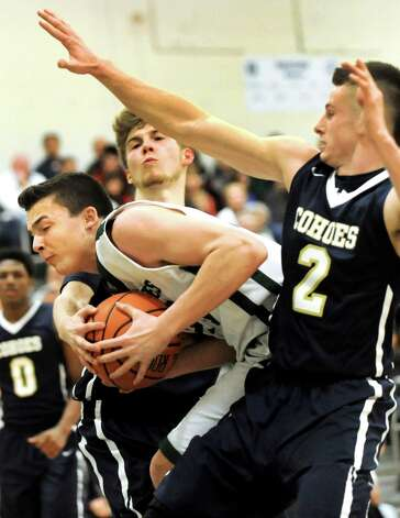 Schalmont's Matt Bird, center, runs into heavy traffic from Cohoes' Thilo Bell, left, and Brandon Laforest during their Class B boys basketball game on Friday, Feb. 27, 2015, at Shenendehowa High in Clifton Park, N.Y. (Cindy Schultz / Times Union) Photo: Cindy Schultz / 00030778A