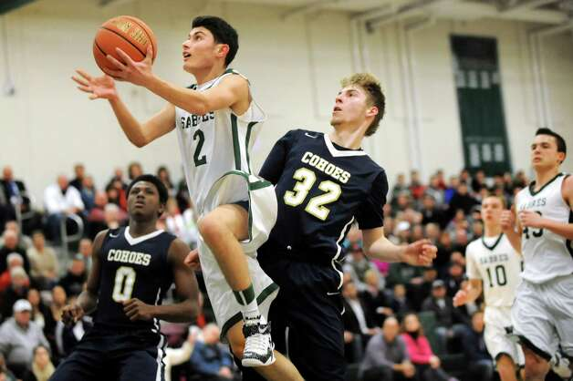 Schalmont's Frank Parisi, center, goes to the hoop as Cohoes' Thilo Bell, right, defends during their Class B boys basketball game on Friday, Feb. 27, 2015, at Shenendehowa High in Clifton Park, N.Y. (Cindy Schultz / Times Union) Photo: Cindy Schultz / 00030778A