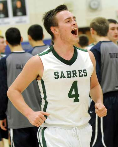 Schalmont's Aidan Frank celebrates their 59-50 win over Cohoes in their Class B boys basketball game on Friday, Feb. 27, 2015, at Shenendehowa High in Clifton Park, N.Y. (Cindy Schultz / Times Union) Photo: Cindy Schultz / 00030778A
