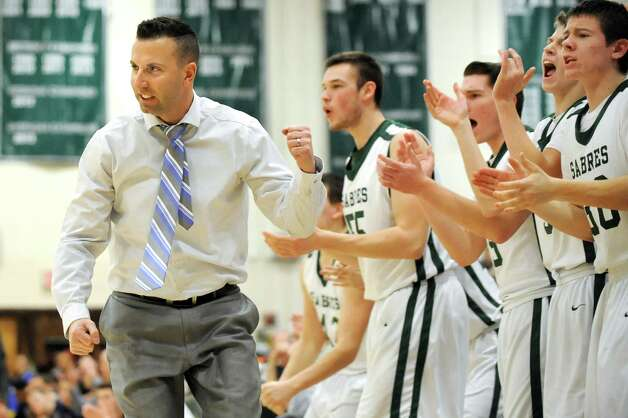 Schalmont's coach Greg Loiacano joins the bench as they celebrate a good play during their Class B boys basketball game against Cohoes on Friday, Feb. 27, 2015, at Shenendehowa High in Clifton Park, N.Y. (Cindy Schultz / Times Union) Photo: Cindy Schultz / 00030778A