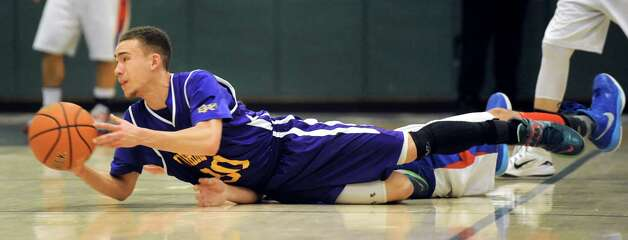 Voorheesville's Isaiah Meaux gets a loose ball and tries to pass during their Class B boys basketball game against Broadalbin on Friday, Feb. 27, 2015, at Shenendehowa High in Clifton Park, N.Y. (Cindy Schultz / Times Union) Photo: Cindy Schultz / 00030778A