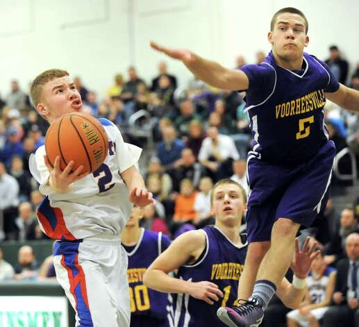 Broadalbin's Robbie Van Brocklin, left, tries to get off a shot as Voorheesville's Shane Parry, right, defends during their Class B boys basketball game on Friday, Feb. 27, 2015, at Shenendehowa High in Clifton Park, N.Y. (Cindy Schultz / Times Union) Photo: Cindy Schultz / 00030778A