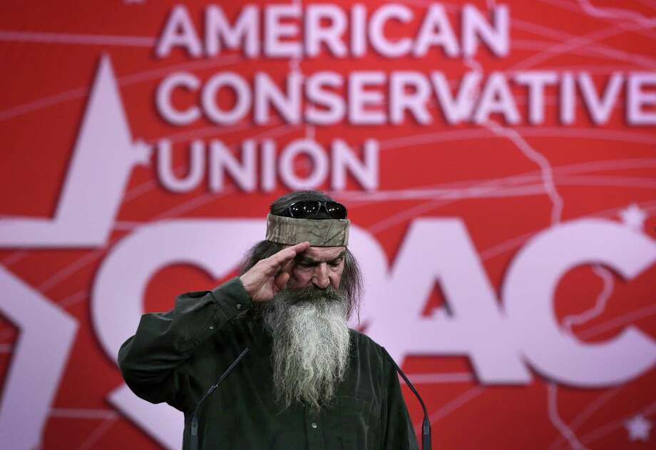 "NATIONAL HARBOR, MD - FEBRUARY 27:  Phil Robertson of TV show ""Duck Dynasty"" salutes as he speaks during an interview at the 42nd annual Conservative Political Action Conference (CPAC) February 27, 2015 in National Harbor, Maryland. Conservative activists attended the annual political conference to discuss their agenda.  (Photo by Alex Wong/Getty Images) Photo: Alex Wong, Staff / Getty Images / 2015 Getty Images"