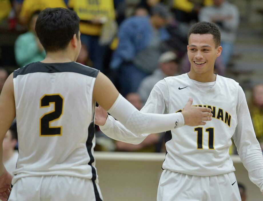Brennan's DeShawn Key, right, and Jake Valero, celebrate near the end of a high school playoff basketball game against Madison, Friday, Feb. 27, 2015, at Alamo Convocation Center in San Antonio. (Darren Abate/Express-News) Photo: Darren Abate, FRE / Darren Abate / Express-News