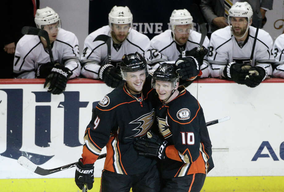 Anaheim's Corey Perry (10) celebrates with Cam Fowler after one of his two third-period goals against Los Angeles. Photo: Jae C. Hong / Associated Press / AP