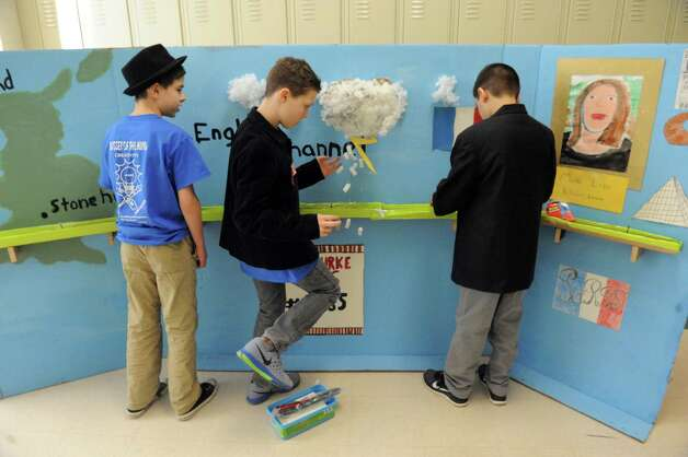 Burnt Hills O'Rourke Middle School students Christian Erickson, left, Robbie Suski and Adam Orlando work on their set during the 2015 Odyssey of the Mind Tournament at Shenendehowa High School on Saturday Feb. 28, 2015 in Clifton Park, N.Y. (Michael P. Farrell/Times Union) Photo: Michael P. Farrell / 00030818A