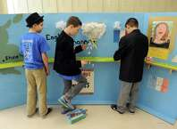 Burnt Hills O'Rourke Middle School students Christian Erickson, left, Robbie Suski and Adam Orlando work on their set during the 2015 Odyssey of the Mind Tournament at Shenendehowa High School on Saturday Feb. 28, 2015 in Clifton Park, N.Y. (Michael P. Farrell/Times Union)