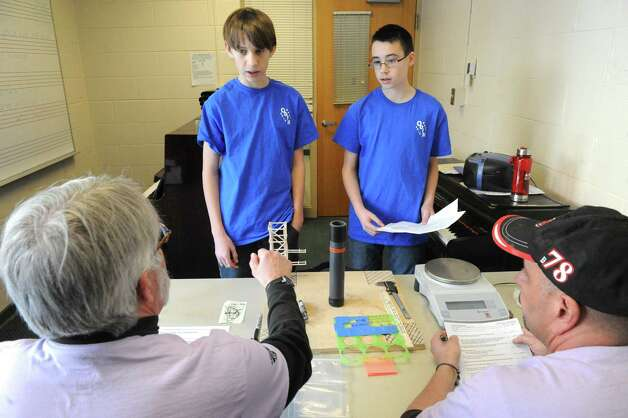 Burnt Hills O'Rourke Middle School students Ben Ellet-Kinslow, left, and Max Nemec weigh in with judges Bruce Romanchak, left, and Jeff Iannotti during the 2015 Odyssey of the Mind Tournament at Shenendehowa High School on Saturday Feb. 28, 2015 in Clifton Park, N.Y. (Michael P. Farrell/Times Union) Photo: Michael P. Farrell / 00030818A