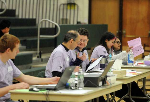 Judges tabulate the scores of the Elsmere Elementary school presentation during the 2015 Odyssey of the Mind Tournament at Shenendehowa High School on Saturday Feb. 28, 2015 in Clifton Park, N.Y. (Michael P. Farrell/Times Union) Photo: Michael P. Farrell / 00030818A