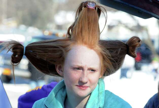 Voorheesville High School student Emma Hampston has her hair styled for her teams presentation during the 2015 Odyssey of the Mind Tournament at Shenendehowa High School on Saturday Feb. 28, 2015 in Clifton Park, N.Y. (Michael P. Farrell/Times Union) Photo: Michael P. Farrell / 00030818A