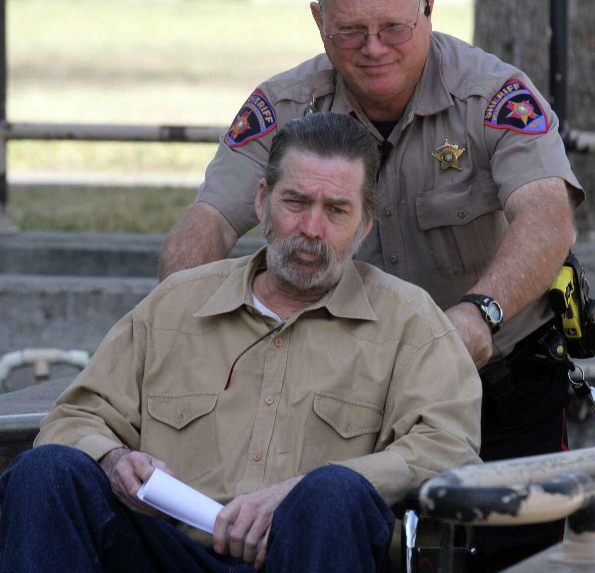 Mark Norwwod is taken out of the Tom Green County Courthouse in San Angelo, Texas, Wednesday, March 27, 2013 after being found guilty of the 1986 murder of Christine Morton. Norwood was sentenced to life in prison. Morton's husband, Michael Morton, was originally convicted of the crime and spent 25 years in prison before DNA evidence exonerated him in 2011. The same evidence implicated Norwood in the murder. (AP Photo/San Angelo Standard-Times, Patrick Dove)