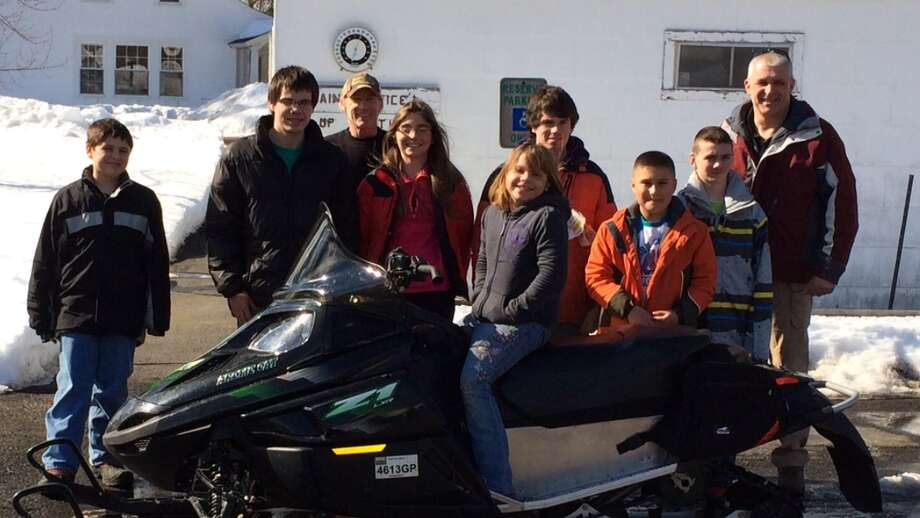 Columbia County Sheriff David P. Bartlett stands with members of the 2014 snowmobile safety class. (Submitted photo)