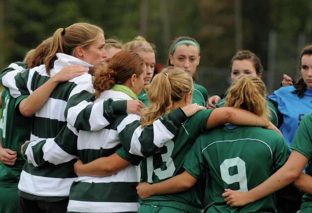Shenendehowa head coach Holli Mulholland, left, talks with her team before the start of  their girls high school soccer match against Bethlehem in Delmar Tuesday afternoon 10/05/2010. (Michael P. Farrell / Times Union) Photo: Michael P. Farrell / 00010510A
