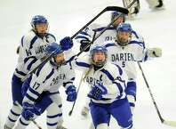 Darien's Sammy Nielsen, second from right, celebrates her game-tying goal with teammates from left, Julia Arrix (#14), Chandler Kirby (#17), Marissa Baker (#6) and Katie Zaro (#5)l in the third period of the FCIAC girls high school hockey final between Darien High School and Ridgefield High School at Terry Connors Rink in Stamford, Conn., Saturday afternoon, Feb. 28, 2015. The goal tied the game at one. Darien was crowned FCIAC Champ with a 3-1 victory over Ridgefield.