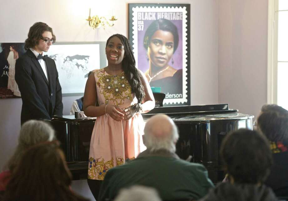 "Delecia Woods, of Waterbury, performed with other voice students from Western Connecticut State University, repeating their performances from a February 9th WCSU concert, in the Marian Anderson Studio at the Danbury Museum on Saturday, February 28, 2015, in Danbury, Conn. The original WCSU concert was a recreation of Marian Anderson's final concert from her 1964 final tour. Woods sang ""Oh, What a Beautiful City"". February 27th was Anderson's birthday and the Museum held an open house to celebrate. Photo: H John Voorhees III / The News-Times"