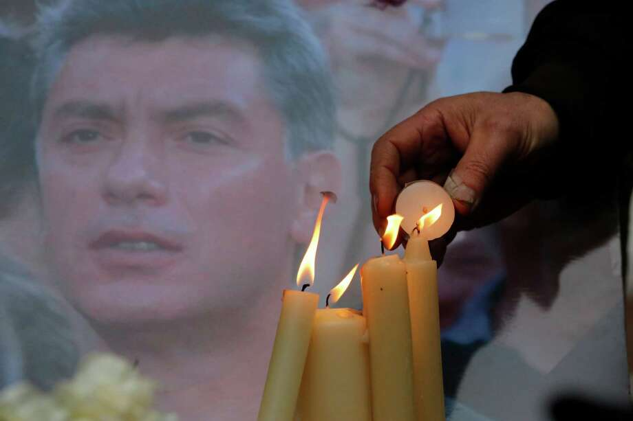 People light candles in memory of Boris Nemtsov (pictured) at the Solovetsky Stone in St. Petersburg. Photo: Dmitry Lovetsky / Associated Press / AP