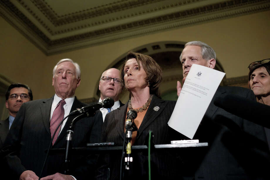 Nancy Pelosi on Friday shows a letter she sent urging fellow Democrats to support a stopgap homeland security funding bill. Photo: T.J. Kirkpatrick / Getty Images / 2015 Getty Images