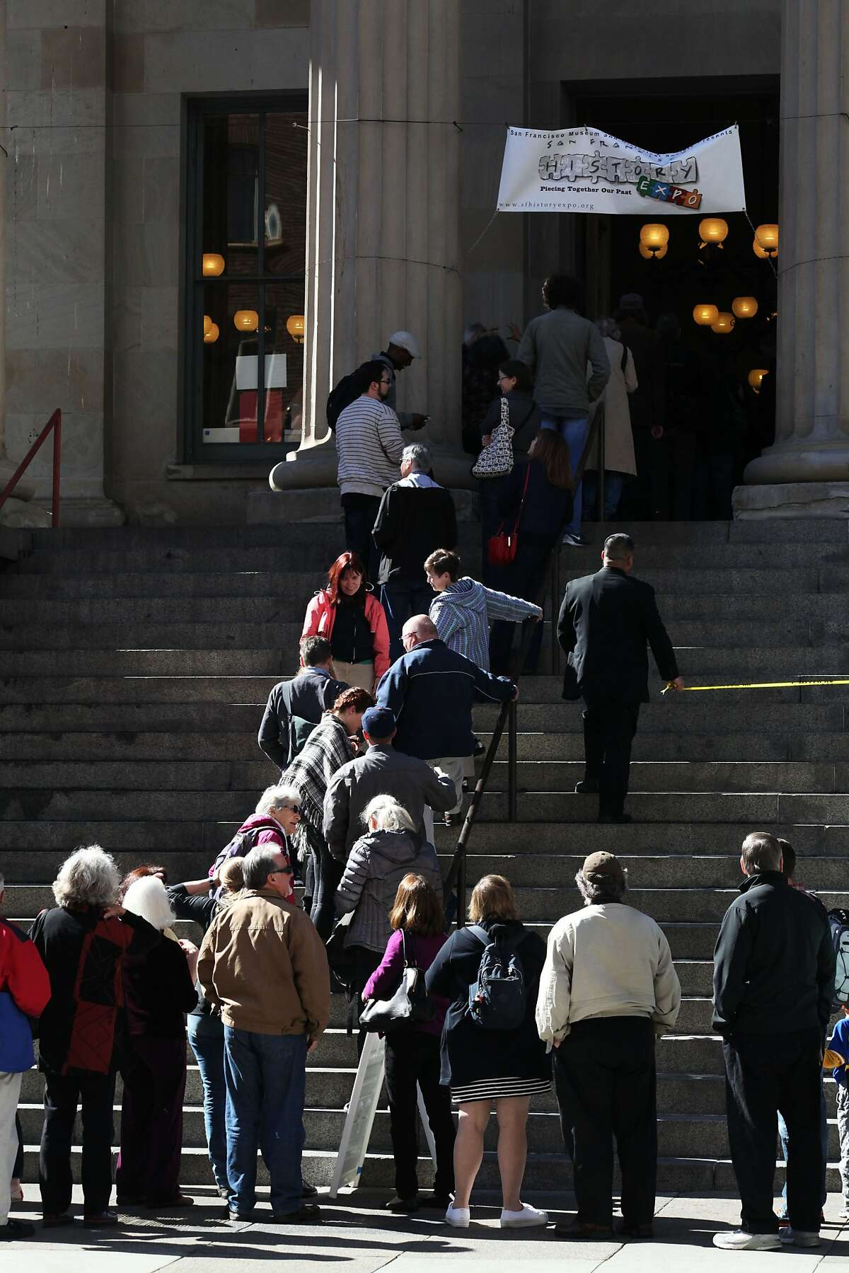 People stream into the Old Mint for SF History Expo right when it opens in San Francisco, Calif., Saturday February 28, 2015.