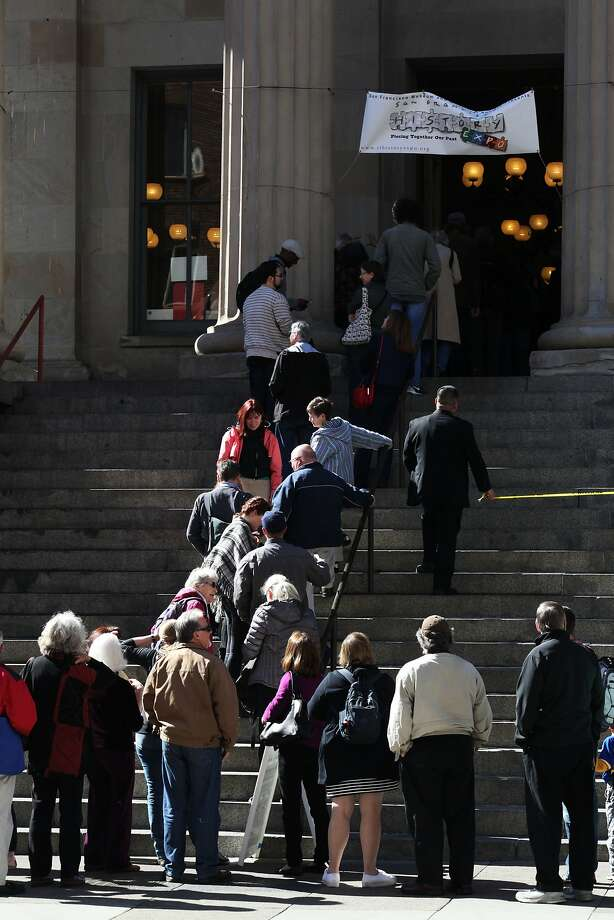 A line of people waits to get into the San Francisco History Expo as it opens on Saturday morning. Photo: Sophia Germer, The Chronicle