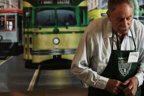 Mike Sheridan works at the Market Street Railway's table, which had vintage bus tokens on display.