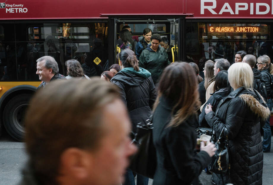Seattle commuters with lower incomes will receive discount fares under a program that began Sunday. Photo: IAN C. BATES / New York Times / NYTNS