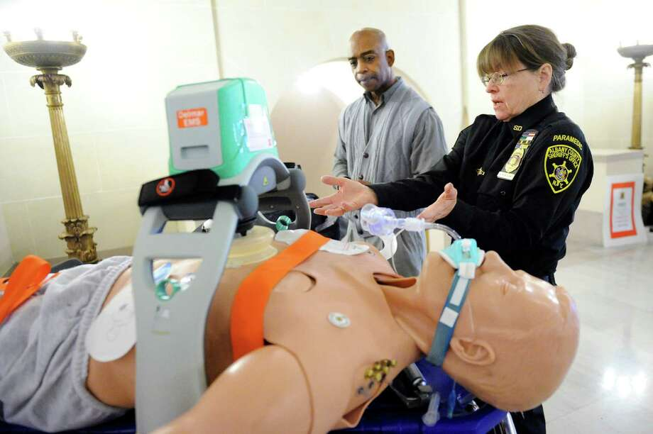 Nancy Montesano, paramedic supervisor, right, demonstrates a Lucas device for Garry Horne, director of community and emergency services, during the Albany County Sheriff's Open House on Saturday, Feb. 28, 2015, at the Albany County Courthouse in Albany, N.Y. The Lucas device perfectly delivers mechanical compressions to people in need of CPR. (Cindy Schultz / Times Union) Photo: Cindy Schultz / 00030802A