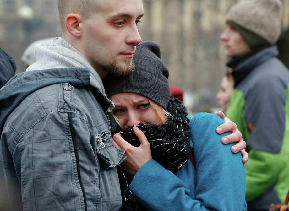 People react as they gather in memory of Boris Nemtsov near the monument of political prisoners 'Solovetsky Stone' in central St.Petersburg, Russia, Saturday, Feb. 28, 2015. Nemtsov was gunned down Saturday near the Kremlin, just a day before a planned protest against the government. (AP Photo/Dmitry Lovetsky) Photo: Dmitry Lovetsky, STF / Associated Press / AP