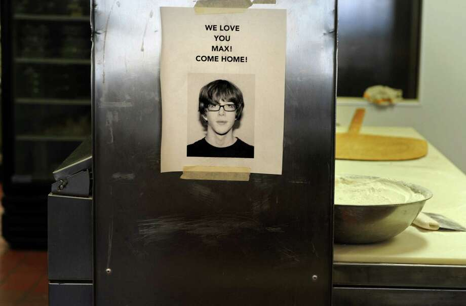 A flyer hangs in the kitchen at Maione's Pizza on Stratfield Rd. in Fairfield to show support for missing Rochester Institute of Technology student Max Maisel, who grew up in Fairfield. Photo: Autumn Driscoll / Connecticut Post