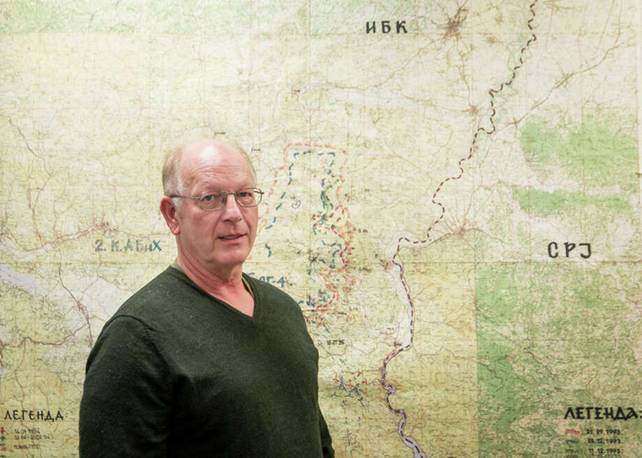 Michael MacQueen, of Immigration and Customs Enforce ment, stands in front of a tactical map of Bosnian Serb forces at Srebren ica. Photo: DREW ANGERER / New York Times / NYTNS
