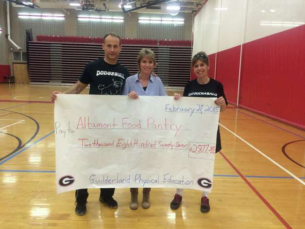 "Organizers and participants in the seventh annual Dodgeball tournament at Guilderland High School on Friday raised $2,877.25 for the Altamont Food Pantry.  The dodgeball champions were the ""Pillsbury Throwboys""  More than 240 students participated and 60 staff members played and assisted. (Mike Schaffer)"