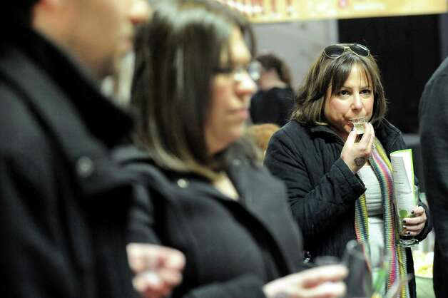 Cheryl Patack of Albany, right, sips a hard cider sample during a one-year anniversary party on Saturday, Feb. 28, 2015, at Nine Pin Cider Works in Albany, N.Y. (Cindy Schultz / Times Union) Photo: Cindy Schultz / 00030817A