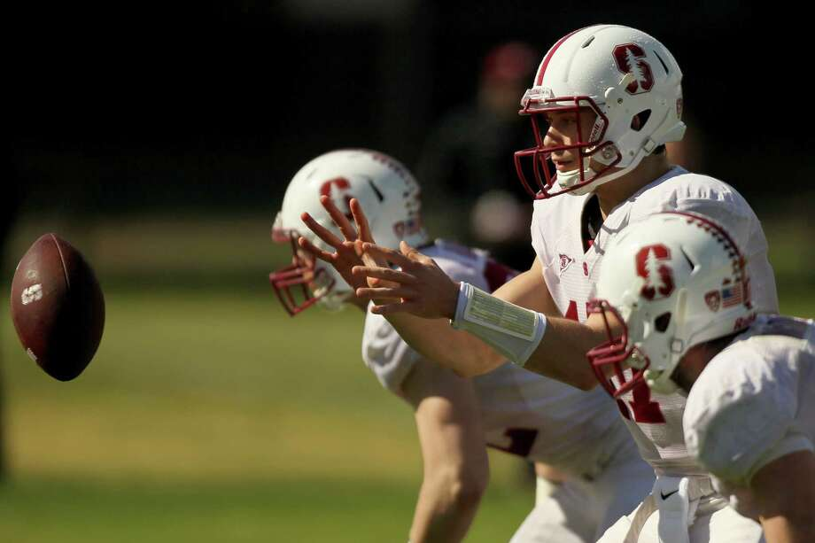 Sophomore Ryan Burns, battling to be Stanford's No. 2 quarterback, takes a snap during Stanford's practice Saturday. Photo: Santiago Mejia / The Chronicle / ONLINE_YES