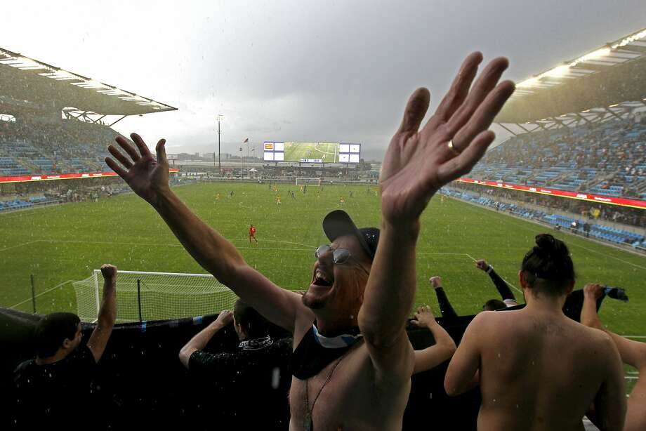 A San Jose Earthquakes fan, who did not want to give his name, cheers with other fans seated in the Quakes Zone as hail begins to fall onto the pitch during an MLS friendly soccer match against the Los Angeles Galaxy at Avaya Stadium, Saturday, Feb. 28, 2015, in San Jose, Calif. Photo: Santiago Mejia, The Chronicle