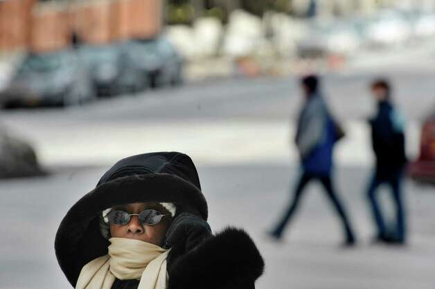 Rosalind Hughes of Albany is bundled up against the cold as she makes her way across State St. on Wednesday, Feb. 25, 2015, in Albany, N.Y.     (Paul Buckowski / Times Union)