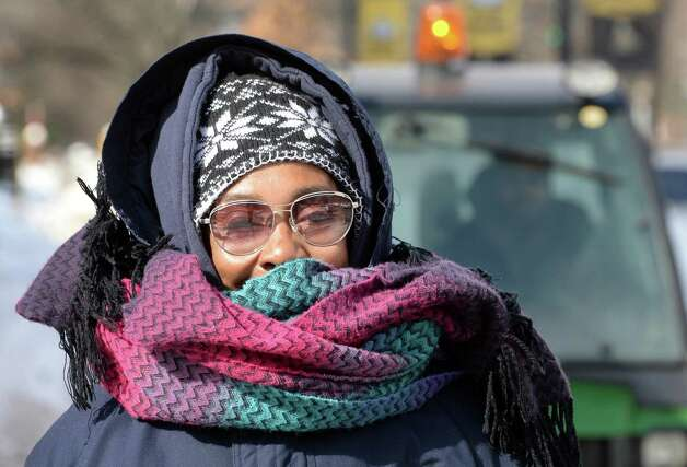 Debra Quattlebaum of Albany bundled up against the cold as she walks down Western Avenue Wednesday Feb, 25, 2015 in Albany, NY.  (John Carl D'Annibale / Times Union) Photo: John Carl D'Annibale / 00030763A
