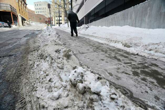 Ice and snow line the sidewalks on Wednesday, Feb. 25, 2015, in Albany, N.Y.     (Paul Buckowski / Times Union)