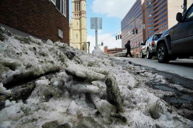 Chunks of ice line the roads and sidewalks on Wednesday, Feb. 25, 2015, in Albany, N.Y.     (Paul Buckowski / Times Union)
