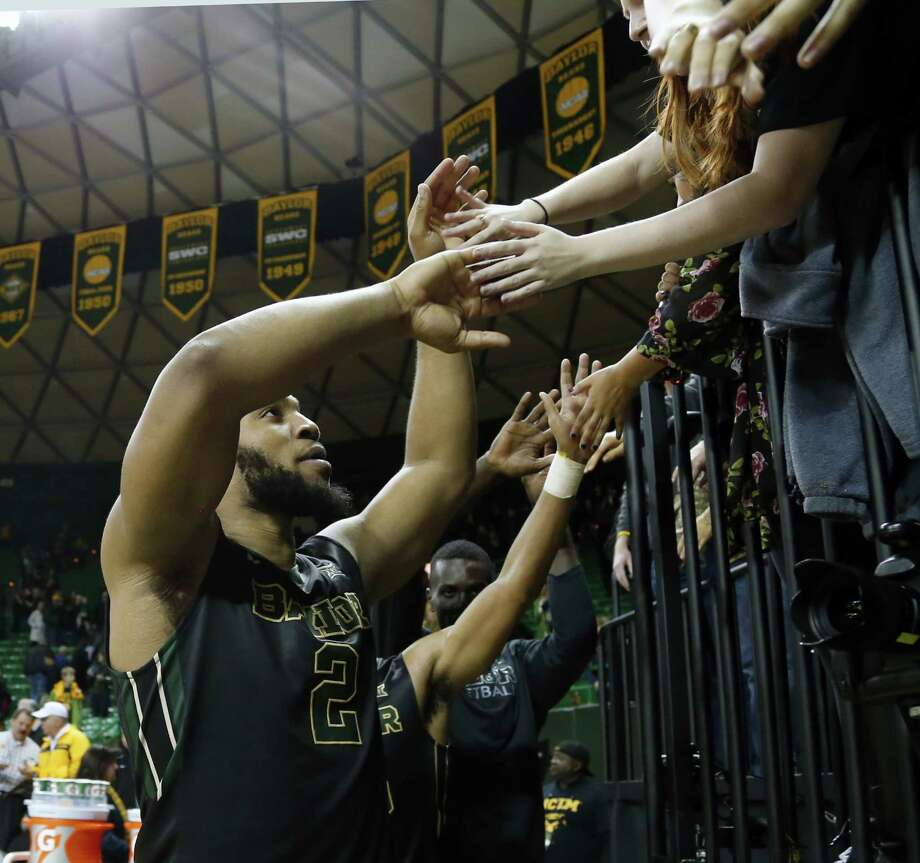 Baylor forward Rico Gathers shakes hands with fans following the game against West Virginia. Photo: Rod Aydelotte /Waco Tribune-Herald / FRE36102AP