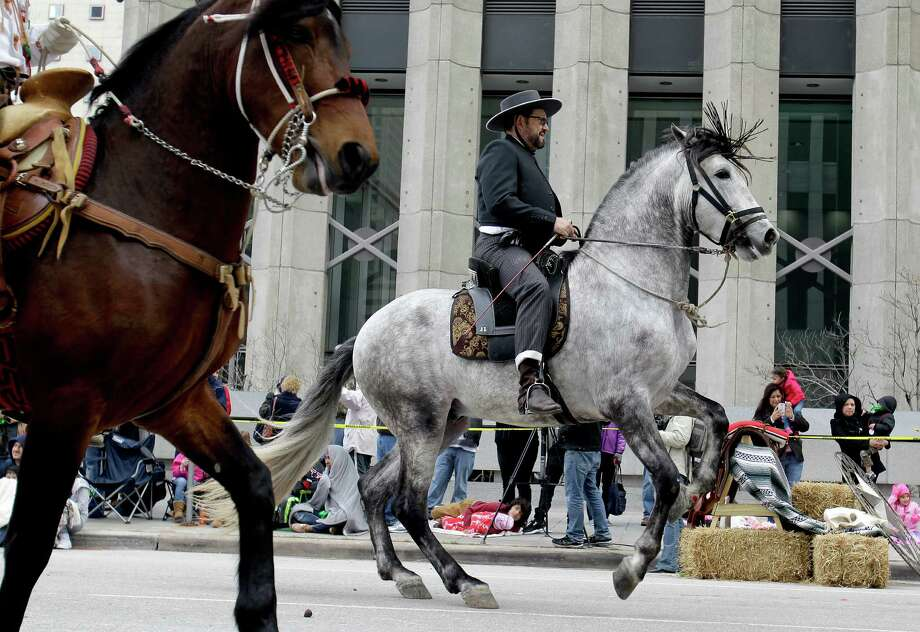 Riders on horses participate in the Houston Livestock Show and Rodeo Parade in downtown Saturday, Feb. 28, 2015, in Houston. Photo: Melissa Phillip, Houston Chronicle / © 2014  Houston Chronicle