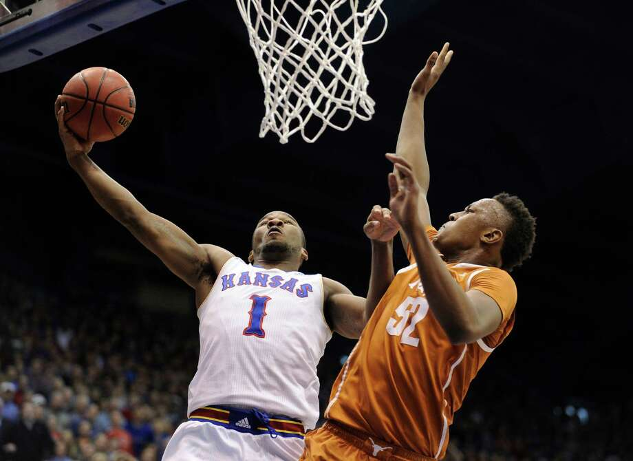 LAWRENCE, KS - FEBRUARY 28: Wayne Selden Jr. #1 of the Kansas Jayhawks lays the ball up against Myles Turner #52 of the Texas Longhorns in the first half at Allen Fieldhouse on February 28, 2015 in Lawrence, Kansas. (Photo by Ed Zurga/Getty Images) Photo: Ed Zurga, Stringer / Getty Images / 2015 Getty Images