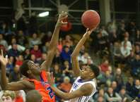 Westhill's Jeremiah Livingston takes a shot against Danbury during Saturday's FCIAC quarterfinal game at Fairfield Ludlowe High School on February 28, 2015.